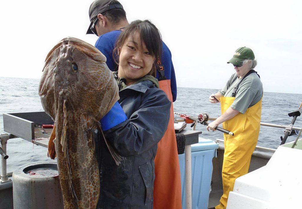 Laurel Lam holds up a lingcod.